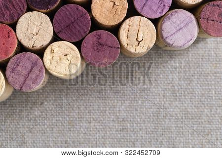 Wooden Cork Close-up Of Bottles With Red And White Wine. View From Above. Natural Background Of Wood