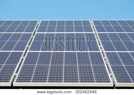 Solar Panel On Roof Close Up. Alternative Electricity Source - Ecological Power Generation.