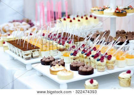 Candy Bar With Macarons, Cakes, Cake Pops, Close Up.