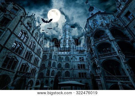 Marienplatz At Night, Munich, Germany. Creepy Mystery View Of Dark Gothic Town Hall With Bats. Old S