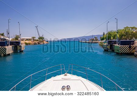 Passing Through The Corinth Canal By Yacht, Greece. The Corinth Canal Connects The Gulf Of Corinth W