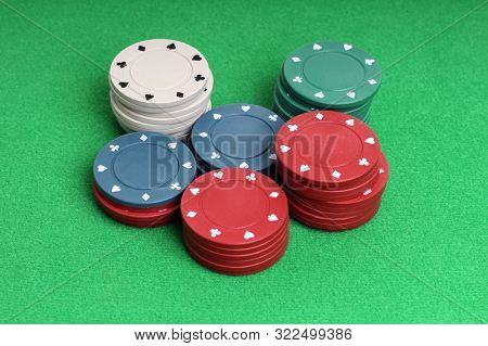 Chips for casino with on green background