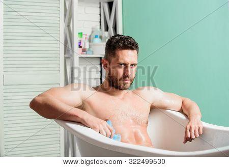 Man Wash Muscular Body With Foam Sponge. Macho Naked In Bathtub. Macho Attractive Nude Guy. Sexy Man