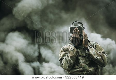 Military Soldier Testing Gas Mask Between Smoke And Gas In Battlefield