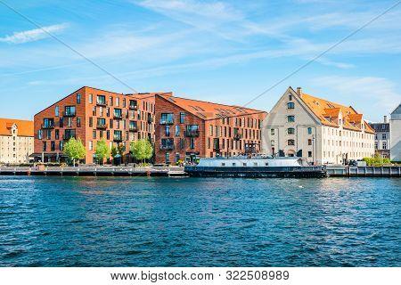 Kroyers Plads buildings in the Christianshavn neighbourhood of central Copenhagen, Denmark. View from Havnepromenade. poster
