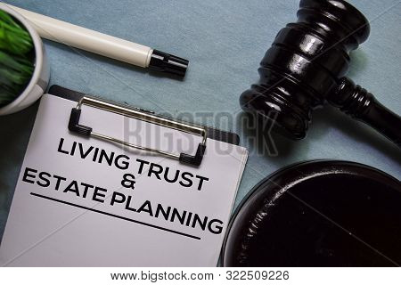 Living Trust And Estate Planning Text On Document Form And Gavel Isolated On Office Desk.
