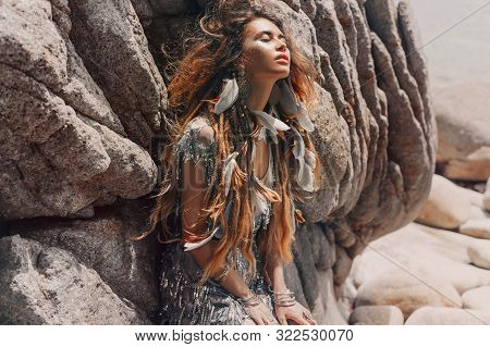 Beautiful Young Woman With Feathers In Hairoutdoors Portrait