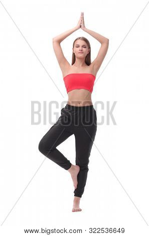young woman performing fitness exercises . isolated on white
