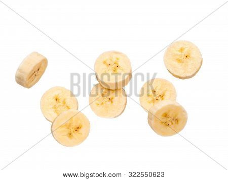 Several Banana Slices, Isolated On White Background With Clipping Path. Peeled Falling Slices Of Ban
