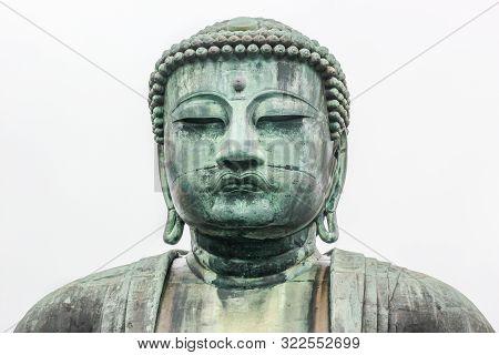 Monumental Bronze Statue Of Amitabha Buddha. Kamakura Daibutsu On White Background.