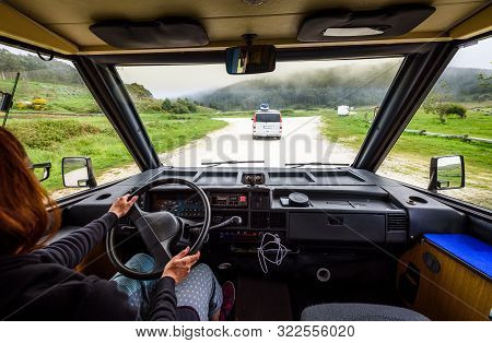 Driving Motorhome Or Campervan On The Road Outdoors In Nature.