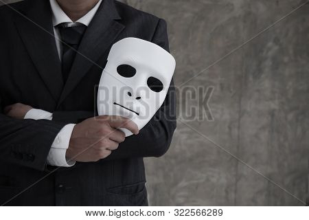 Businessman Holding White Mask In His Hand Dishonest Cheating Agreement.faking And Betray Business P