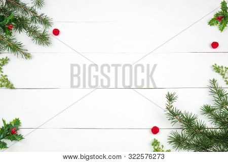 Creative Christmas Layout. Fir Twigs And Red Pompons. White Wood Background Whit Copy Space. Border