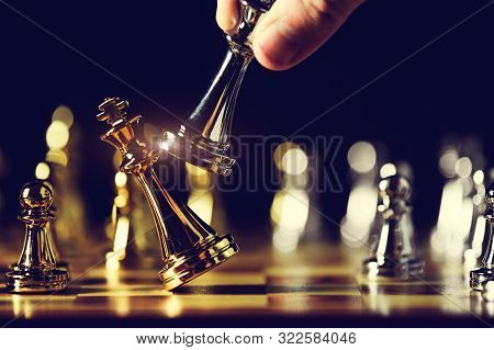 Closeup King Chess Piece Defeated Enemy Or Trade Competitor By Checkmate At End Of Chessboard Game.