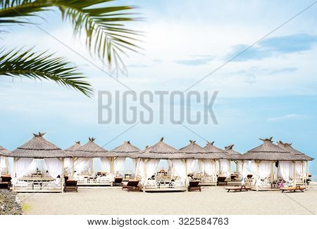 Comfotable Tents With Canopy And Sofas On Vip Beach Seascape