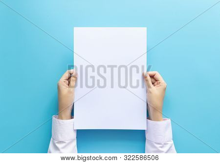 Close Up Hands Holding  Empty White Blank Letter Paper Size A4 For Flyer Or Invitation Mock Up Isola