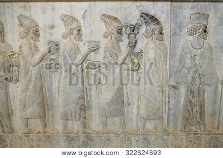 A Bas-relief Depiction Of Lydian Embassy Tribute Bearers Carry Present For The King At Apadana, East