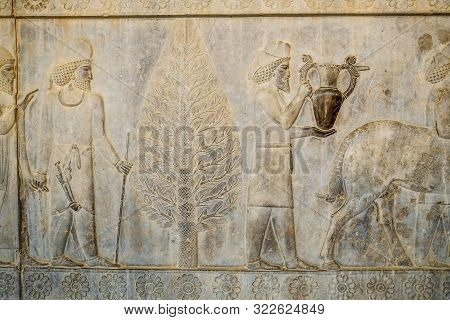 A Bas-relief Depiction Of Armenian And Babylonian Tribute Bearer Men Carry Present For The King At A