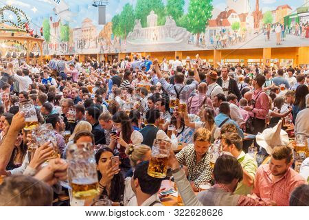 Munich, Germany - September 17, 2016: People Drink Beer In The Hacker-pschorr Tent Of The Oktoberfes