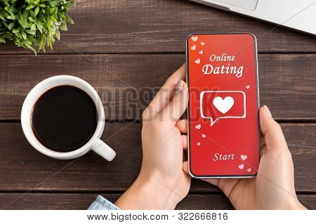Online Dating App. Woman Using Date Application On Smartphone, While Drinking Coffee. Copy Space