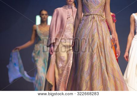 Sofia, Bulgaria - 28 March 2019: Female Models Walk The Runway In Beautiful Colorful Dresses During