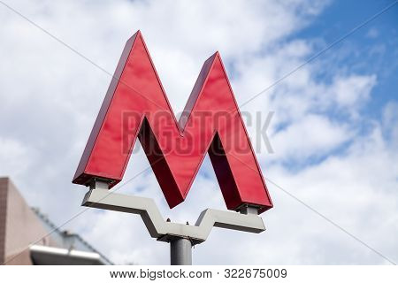 Russia Moscow 2019-06-17 Big Red Letter M, Symbol Of The Moscow Metro On Blue Sky Background