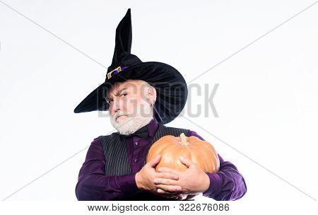 Bearded Man Ready For Halloween Party. Happy Halloween. Evil Wizard Hold Orange Pumpkin. Mature Man