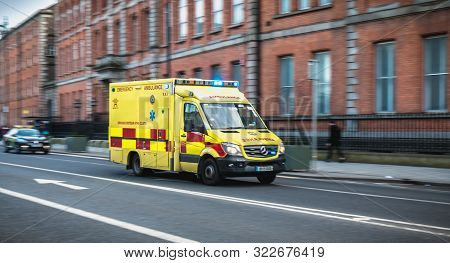 Dublin, Ireland - February 16, 2019: Irish Ambulance Driving Fast On The Streets Of Dublin On A Wint