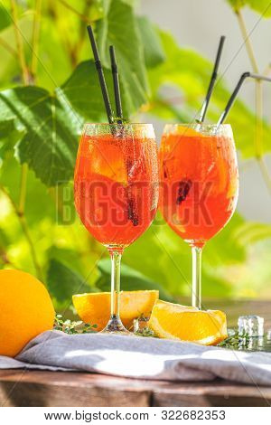 Two Aperol Spritz Cocktail In Big Wine Glass With Oranges, Summer Italian Fresh Alcohol Cold Drink.