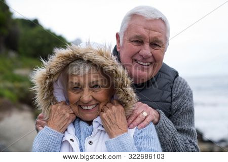 Portrait of senior couple having fun together at beach