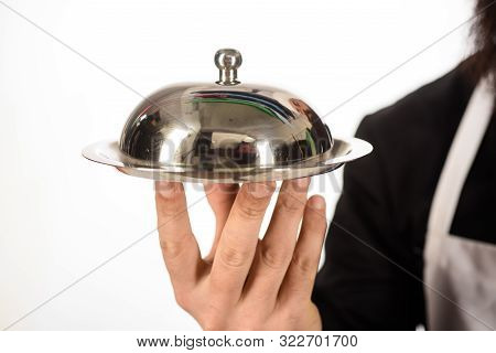 Hand Of Waiter With Metal Cloche Lid Cover. Butler Concept. Presentation. Restaurant Serving. Waiter