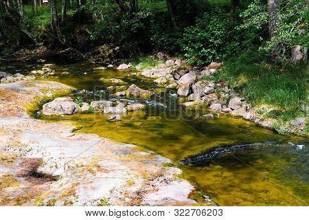 Finland, Kotka: Langinkoski Rapid On The Kumi River, Fast Forest Creek With Boulders.