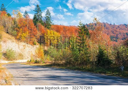 Country Road Through Forest In Mountains. Beautiful Transportation Autumn Scenery In The Morning. Tr