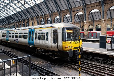 LONDON,UK -AUGUST 16,2019 : Trains at the platform at King's Cross station in London