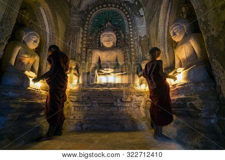 Buddhist Monks Praying Inside Bagan Temple, Myanmar  - 08/10/2016
