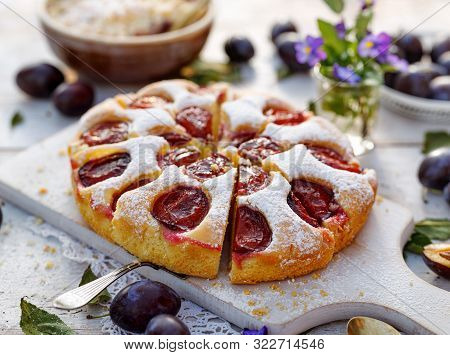 Plum Cake, Traditional Homemade  Cake With Fruit, Divided Into Portions, Sprinkled With Powdered Sug