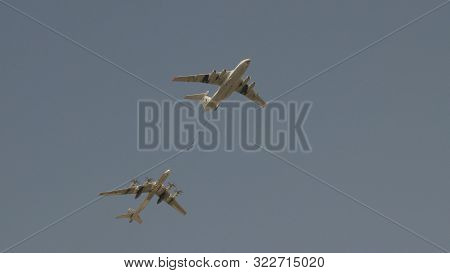 Moscow - May 7: Bombers Tupolev Tu-160 And Tu-95 Refueling In The Air Fly In Sky On Training Parade