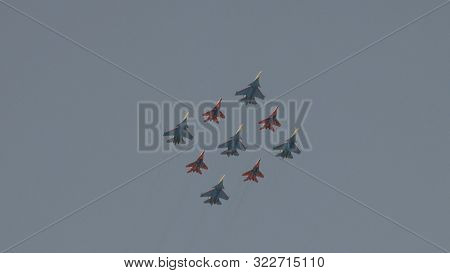 Moscow - May 7: Fighters Su-35 And Mig-29 Lined Diamond Fly With Fireworks Fly In Sky On Training Pa