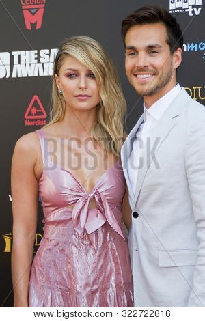 Melissa Benoist and Chris Wood arrive at the 45 Annual Saturn Awards on Sept. 13, 2019  at the Avalon Theater in Hollywood, CA.