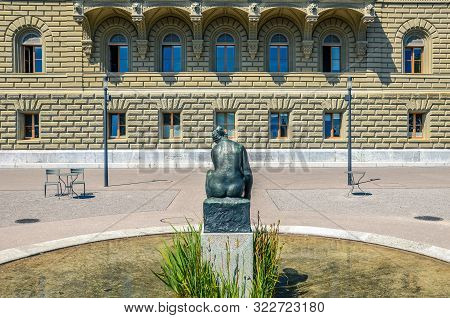Bern, Switzerland - August 14, 2019: Sculpture Of Naked Woman Photographed From Behind Close To The