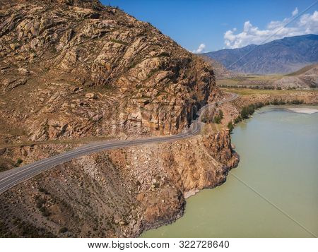 Road in Altai mountains. Chuysky tract in Altai Republic, Siberia, Russia. This road is one of the ten most beautiful roads in the world.