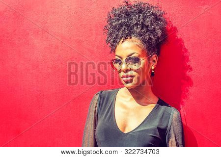 Portrait Of Young African American Woman In New York. Young Black Woman With Afro Hairstyle Wearing