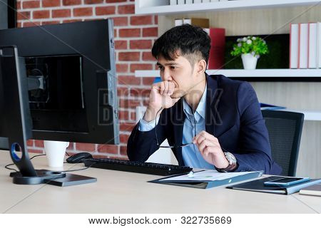 Young Asian Office Man Struggle With Computer, Frustrated Asian Business Man Looking At Computer Whi