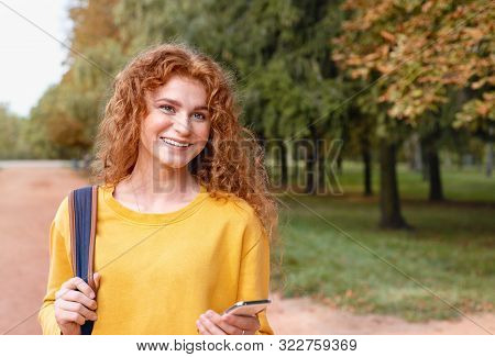 Smiling Happy Red Hair Student Girl Outside In Autumn Park
