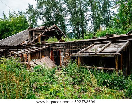 Old, Destroyed Wooden House. House Without Tenants. Ready To Demolish The House