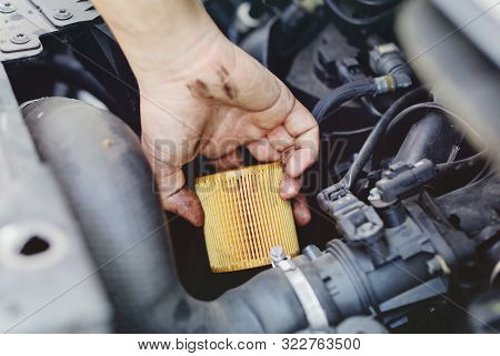 Close Up Hand Of Unrecognizable Mechanic Doing Car Service And Maintenance - Oil And Fuel Filter Cha