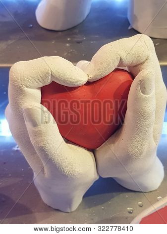 poster of Adult woman and men hand hold a red heart, health care love, give, hope and family concept.