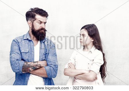 Theres Constant Quarreling In Their Family. Father And Little Daughter Quarreling On Grey Background