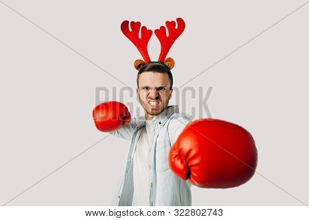 A Guy In Boxing Gloves Hits The Camera. The Man Is Determined To Break Prices. Knocks Out Discounts.