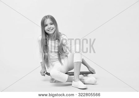 Girl Likes To Ride Skateboard. Active Lifestyle. Girl Having Fun With Penny Board Pink Background. K